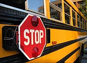 Drivers need to remember to always stop for school buses that are loading and unloading students. It's the law. (©istockphoto)